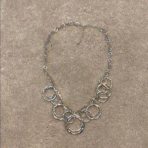Silver colored costume necklace